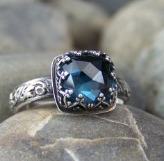 Deep Waters Ring - 8mm Cushion Rose Cut London Blue Topaz in Heart Crown Bezel. $122.00, via Etsy.