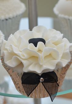 Gorgeous wedding cupcakes. navy liners, silver button heart???