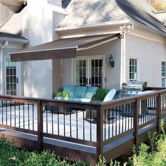 An awning creates a comfortable shaded outdoor dining space, from about $500 for an 8-foot-wide manually operated model.   Photo: Courtesy of Solair   thisoldhouse.com