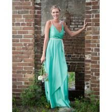 100% organic cotton sateen dress. Floor-length wrap dress with organic cording detail. Top is lined. This dress is perfect for an outdoor wedding! | Green Bride Guide
