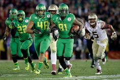 Linebacker Tony Washington #91 of the Oregon Ducks runs back a fumble by quarterback Jameis Winston #5 of the Florida State Seminoles for a 58-yard touchdown in the third quarter of the College Football Playoff Semifinal at the Rose Bowl Game presented by Northwestern Mutual at the Rose Bowl on January 1, 2015 in Pasadena, California. (Dec. 31, 2014 - Source: Ezra Shaw/Getty Images North America)