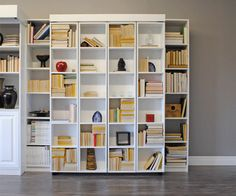The Bi-Folding library murphy bed by www.motivointeriors.com