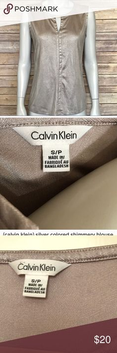 Calvin Klein Metallic silver colored Top Calvin Klein sleeveless Top. In a metallic silver color with interesting texture/print on it. Silver detail at neck with small logo on it. Soft easy wear top. Excellent Condition. Calvin Klein Tops