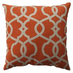 A burnt orange pillow like this would make a great accent.  I think you could go with a more subdued pattern, but the earthy tone of the orange would pair well with the beige walls and chocolate leather.