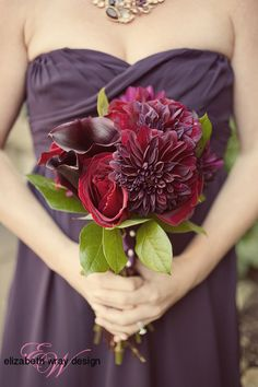 Our bridesmaid's variety of deep reds are a beautiful contrast to her plum dresses. Elizabeth Wray Design-Geneva,IL