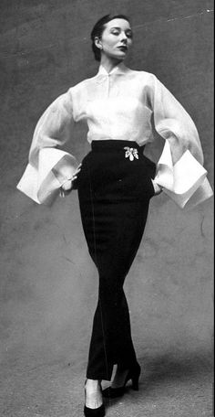 Bettina wearing a white organdy shirt with huge folded cuffs and a black skirt by Jeanne Lanvin. Photograph by Gordon Parks for LIFE Magazine. Jeanne Lanvin, Fashion Week Paris, Spring Fashion, London Fashion, Moda Fashion, 1950s Fashion, Vintage Fashion, Edwardian Fashion, Gothic Fashion