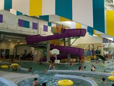 Federal Way Community Center          A two-story water slide, with banked turns and curly cues, is the focal point of oubound to thrill swimmers of all ages (must be 48 inches or taller). A separate interactive play structure features water sprays and a smaller slide for the little ones. Grab an inner tube and float down the lazy river.
