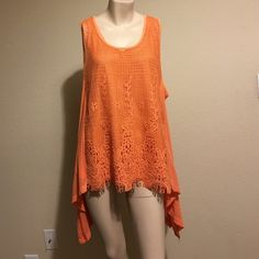"Pretty Angel 2 piece - Tangerine color. 2 piece top can be worn as separates.  Beautiful lace topper with tank underneath.  Topper looks great with white underneath to make it pop.  Shark bite sides.  Approx. 27"" length in front and back.  Sides are approx. 34"" from shoulder.  Bust has ample room as this top is a full cut.  Great for summer.  Tangerine color. Also available in White and Turquoise in my closet. Pretty Angel Tops Tunics"