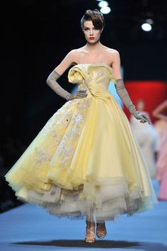 John Galliano's haute couture gown for Christian Dior.  Looks like a 1950's gown!