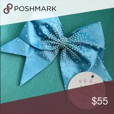 """Bows of London """"Pearl"""" Cheer Bow This bow has never been used and comes with the original tag. It has been discontinued for a while now and it's in perfect condition. Bows of London Accessories Hair Accessories"""