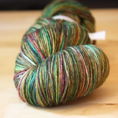 Tourmaline jewel tones in a 50/50 merino wool/silk fingering weight yarn - hand dyed by phydeaux designs (only skein in this colorway in the world!),
