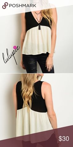 """S-L Two Tone Color Block Essential Top This sleeveless top features a combination color scheme, v-neckline and baby doll silhouette. Measurements for small: 23"""" Bust: 36""""  Made of 100% Rayon Bchic Tops"""