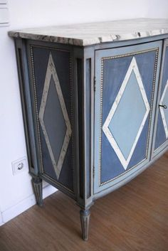 Louis XVI style sideboard with faux marble painted top