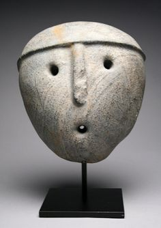 """Pre-Columbian, Aguada Culture, Argentina, ca. 1000 CE. An important and dramatic minimalist stone mask of this rare culture hardly known to us due to its lack of monumental architecture. Its mouth is pointed because it's a shamanic mask of a """"life-giver,"""" life that is blown by a shaman into matter that needs healing"""