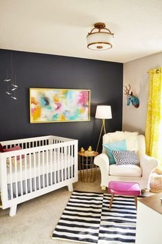 Dark gray walls gives a good contrast to the lighter colors of furniture pieces
