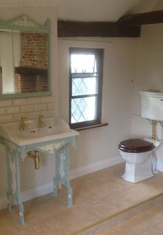 Beautiful Sink and Toilet to match original features of Tudor Period.