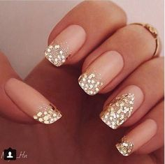 Nude nail polish with gold glitter