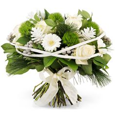 Our traditional white Christmas bouquet is created by hand with elegant soft white roses and Gerbera daisies with lovely seasonal accents.