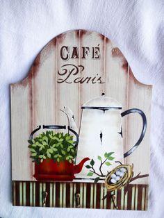 Porta-xícaras confeccionada em mdf trabalhada com pintura artística, aplicação de stencil, e técnica de envelhecimento com proteção de verniz especial.    Decora sua cozinha ou aquele cantinho especial destinado a degustação de uma bela xícara de café junto aos amigos ou ao ser amado.    Além de ... Coffee Shop Design, Cat Cafe, Decoupage Paper, Diy And Crafts, Stencils, Projects To Try, Hand Painted, Country, Painting