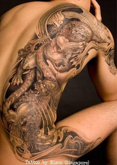 Beautiful chinese lion tattoo on back by Elson Yeo