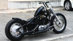 Yamaha V-Star 650 strutted custom with broomstick handlebars, black paint and blacked out engine