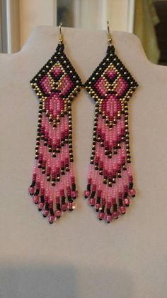 Egyptian Style Beaded Black, Pink, Gold Seed Bead Earrings. Very Pretty and great gift. They are 4 1/2 inch long with Gold ear wires on them, can be changed to post or clips just let me know. If you like but want other color just let me know. Thanks for looking.