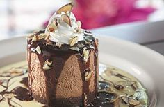 Chocolate Island -- Rich chocolate mousse on a fudge brownie Island in milk chocolate sauce and vanilla bean anglaise.