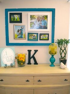 I did something similar in my guest room. I took an empty frame and placed it around several smaller frames. Gallery Wall Frames, Frames On Wall, Framed Wall Art, Gallery Walls, Frame Within A Frame, Craftsman Style Decor, Hanging Photos, Wall Photos, Empty Frames