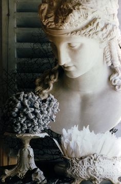 The face of this lovely bust, looks as if she is looking down at the objects below.  So lovely!