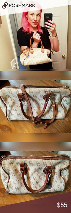 "Super cool, VINTAGE, DOONEY & BOURKE purse!! Love this! Outside shows signs of wear. Especially bottom corners. Inside in good condition. Handles and shoulder strap. Inside zipper pocket. Three inside slide pockets, one with snap closure. 11.5"" wide. 7.5"" tall. Imperfections reflected in price. Dooney & Bourke Bags"