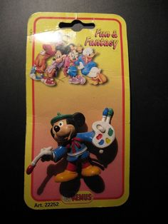 Vintage Old Walt Disney character of Mickey Mouse paints on map..