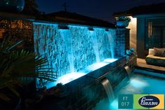Combining different custom swimming pool features, such as waterfalls and colored pool lighting and yield amazing effects.
