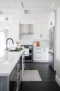 Home Renovation Grey and White Kitchen Renovation - Before and after of a white and grey kitchen renovation featuring silestone countertops and a desk area with a little farmhouse flair. Navy Kitchen, Gray And White Kitchen, White Kitchen Cabinets, Kitchen And Bath, Kitchen Decor, Kitchen Ideas, Kitchen Island, White Kitchen Designs, Kitchen With Dark Floors