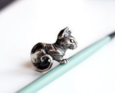 Sphynx cat cuff ring(you can adjust to your size). Made from sterling silver and oxidized. Size ~ 2,5 cm (1 in) horisontal  I admire sphynx cats. So I decided to depict one in a very detiled ring. I tried my best and truely love the result. Ring is sent in a box (the one on the photo)   All jewelry designs are original creations and the wire is all hand bent by me :) Always glad to answer your questions