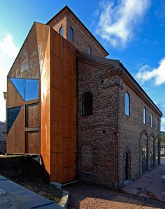 JVA arkitekter converts an old train station transformer into the gallery trafo