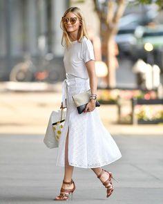 Olivia Palermo in a white T-shirt, Tularosa eyelet skirt, CH Carolina Herrera heels and Céline linen pouch.