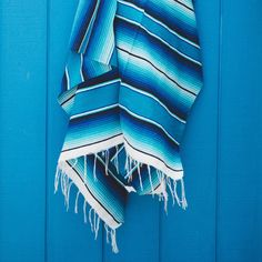 Huge multi-colored Mexican blanket... perfect for the beach, picnic or as a bright home accent. Colors: Dark blue, light blue, black & white Measurements: approximately 5'x7' 100% Acrylic Made in Mexi