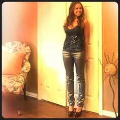"Sexy Sparkle Top~ Sexy sequined top. It's in good condition.  I wore it once. It is lined and no sequins appear gone. It zips down the side. Beautiful blue color. I'm 5'2-1/2"".  I  paired this the blue, silvery, jeans that are also for sale. I offer 15% off bundles of 2 or more items. No Trades!! Julie Tops Camisoles"