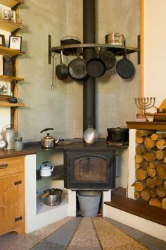 """Pemberton came up with a design that turned the stove into a cooktop. The stove is raised so the top is at countertop height, and it has a big sheet of metal on top, creating varying temperatures for cooking. """"Put it right above the stove and you can boil water, then move it over to simmer,"""" Barnett says."""