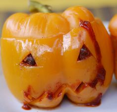 Super-easy spooky spiced slow cooker chili baked in a carved bell pepper for Halloween! #halloween #slowcooker #crockpot