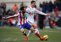 Juanfran slides in to tackle Portuguese star Ronaldo during the first half at the Estadio ...