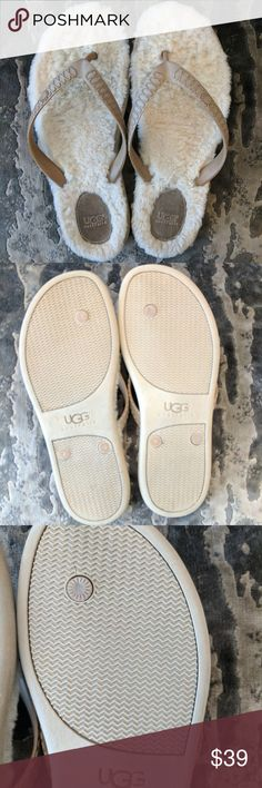 UGG Australia sheepskin flip flops Never worn, great condition however no tags. Soft rubber straps feature an embossed  UGG Australia logo and sheepskin feel so soft and comfortable. Size 9W. One spot has minor crack on the sole (left one) but it is great condition! UGG Shoes Slippers