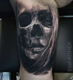Realistic skull and face fusion piece. Tattoo by Eliot Kohek, an artist based in Annecy, France.