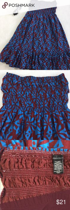 Victoria's Secret Moda International tube dress Victoria's Secret's brand Moda International strapless tube dress in maroon (burgundy) and blue geometric flower design. 100% cotton including lining exclusive of elastic. Elastic bands broken in few places (see pics) -in my opinion doesn't affect function or look when worn- otherwise excellent condition. Approx 31in long and 12in bust un-stretched (measured flat). Cute ruffle around the bottom. Great as a swimsuit cover up, casual summer…
