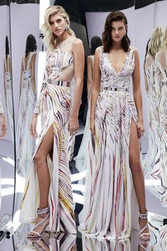 Zuhair Murad Spring 2017 RTW:  I like the multi color patterns on these two gowns. The dress on the left is on trend with the one shoulder. The dress on the right is a classic silhouette.