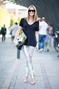 Kristy in a T by Alexander Wang top, Acne pants, and a 3.1 Phillip Lim clutch