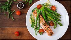 Buy Baked salmon garnished with asparagus and tomatoes with herbs. Top view by Timolina on PhotoDune. Baked salmon garnished with asparagus and tomatoes with herbs. Healthy Recipe Videos, Healthy Chicken Recipes, Healthy Dinner Recipes, Diet Recipes, Healthy Snacks, Healthy Eating, Healthy Herbs, Delicious Meals, Stay Healthy