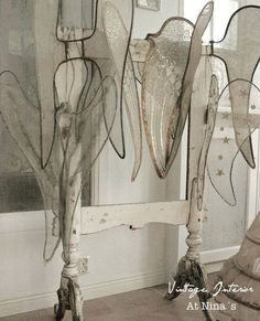 In our home. Collection of old angel wings.