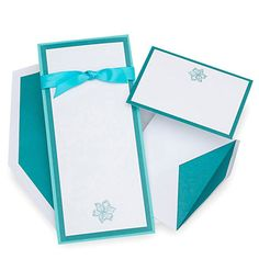 "Brides: Gartner Studios. These tall white invitations feature a teal border and ribbon with an illustrated teal hibiscus flower. This kit contains all you need and includes invitations, response cards, coordinating envelopes, backer sheets and ribbon. Your invitations are custom print-at-home with templates from Gartner Studios. (envelopes are not printable) Contains materials to make 50 4-1/4"" x 9-1/4"" invitations.��view this invitation from Gartner Studios"