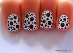 China Glaze White on White as a base and dotted using Rimmel Black Pearl